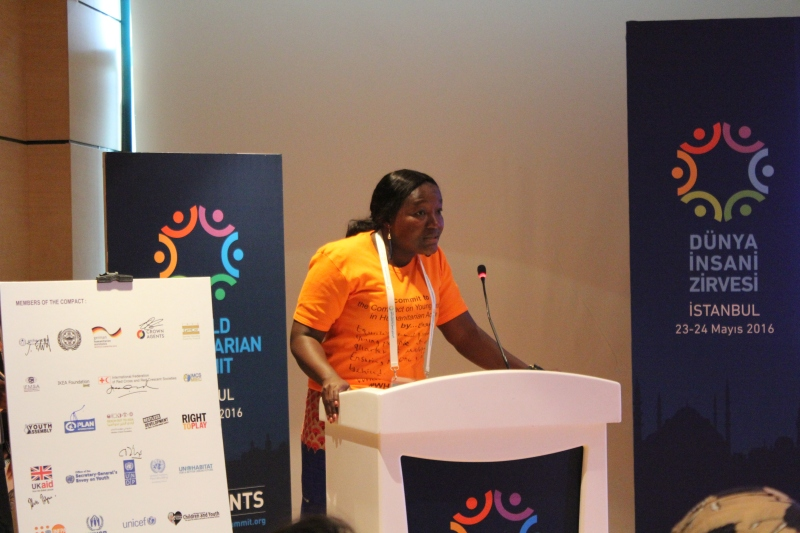 Augusta Jata Ashun signs the Global Compact for Young People in Humanitarian Action on behalf of Restless Development